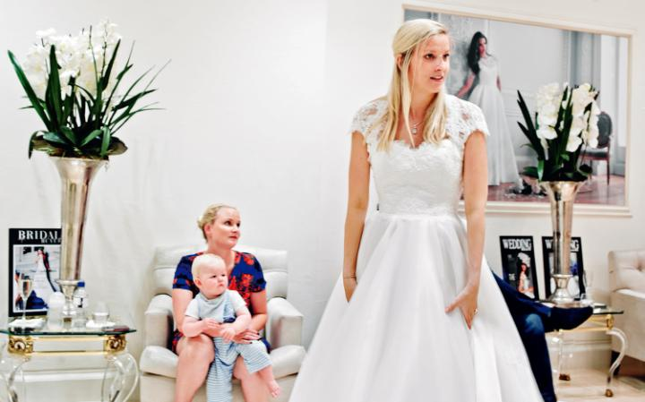 Harriet Mayne tries on a gown for her sister and nephew CREDIT: VICTORIA BIRKINSHAW